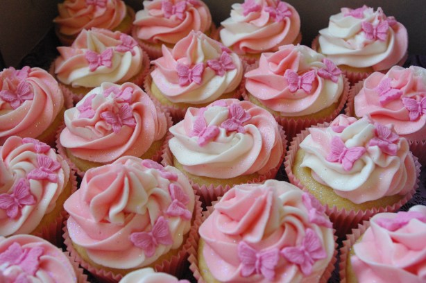 vanilla cupcakes, pink paper cups, strawberry and vanilla butter icing, pink fondant butterflies