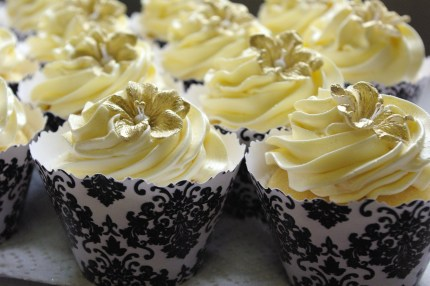 vanilla cupcake, custard buttercream, dusted gold fondant flower, black damask wrapper (collar)