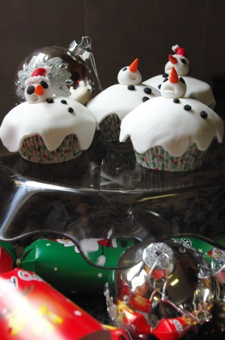 christmas fruitcake with vanilla butter icing and sugar paste Christmas decorations