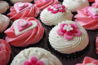 chocolate cupcakes, pink and white sugarpaste hearts, pink and white sugarpaste flowers