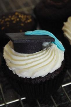 chocolate cupcake, vanilla butter icing, sugarpaste graduation cap