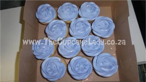 vanilla cupcakes, purple vanilla butter icing rose