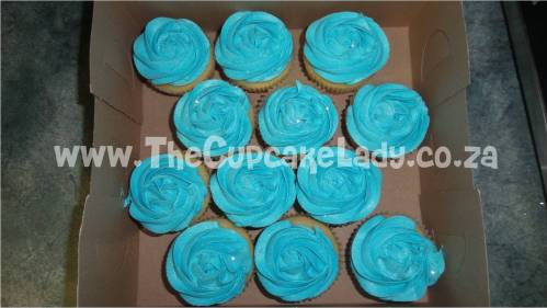 vanilla cupcakes, turquoise vanilla butter icing rose