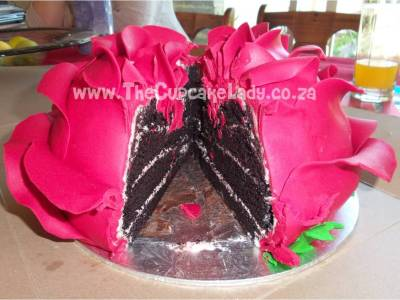 Cake artist, sugar artist, cupcakes, Vorna Valley, Midrand. Giant rose cake, chocolate cake layers shaped into a big red rose.