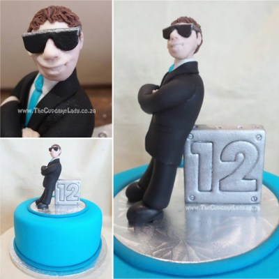 "Midrand cake artist, cupcakes, cakes and sugar art. Birthday boy wanted ""something cool"" on his birthday cake, like a guy in a suit wearing sunglasses. I've been working on my faces, trying to make them more realistic when I want them to be, and I am very pleased with this one. Again – my proportions are a little off, but I think he looks ""cool""!"