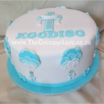 Midrand cake artists - cakes, cupcakes, custom sugar art. Cappuccino christening cake with balloons and bows!
