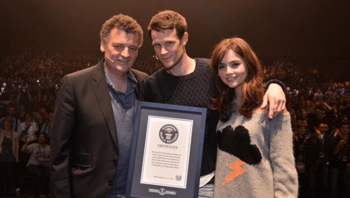 "Steven Moffat, Matt Smith, and Jenna Coleman receive the Guinness World Record. Photo courtesy ""Doctor Who TV"""