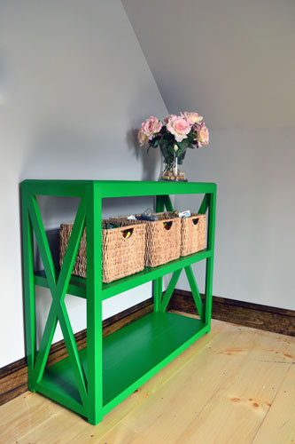 Green Painted Bookcase In Guest Room