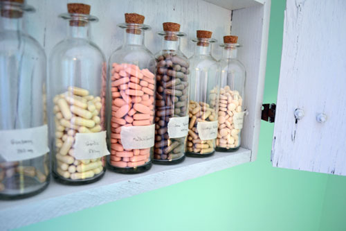 Vitamins Stored In Glass Bottles With Labels