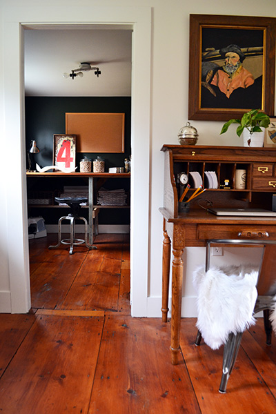 Small vintage rolltop desk in a landing with wide pine floors