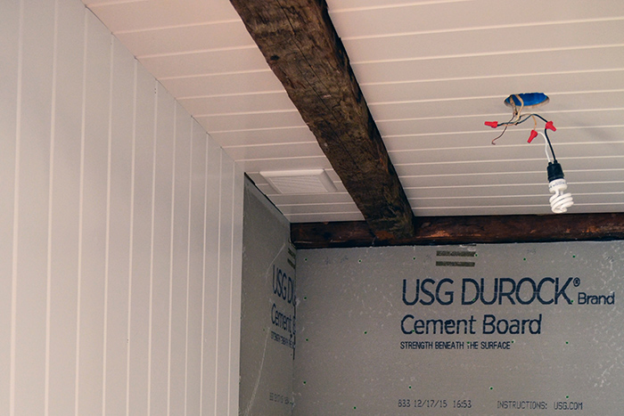 Bathroom wall and ceiling planking installation how-to with rustic wood ceiling beams