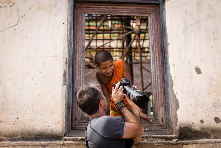 A guest of ours shows his photo to a young monk.