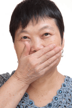 Asian Woman Covering Mouth