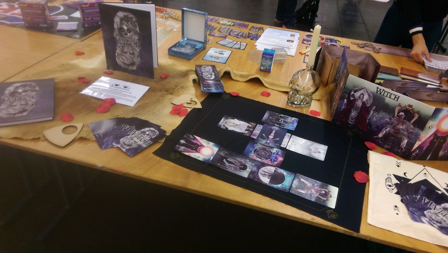 The table was huge, I ended up raiding our booth decoration supplies to make it look nice.