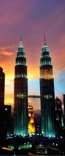 Petronas towers when the sun sets.