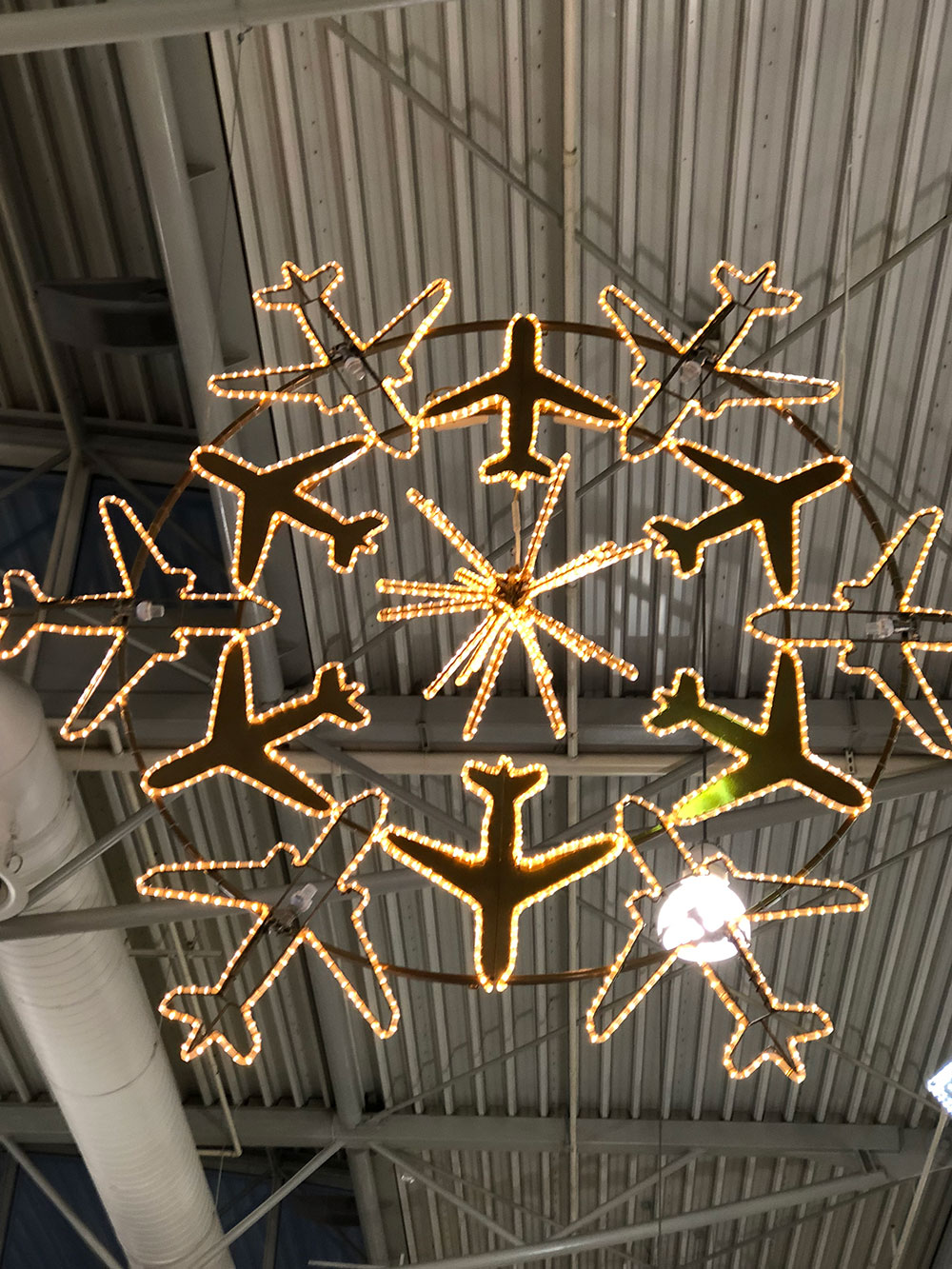 Courier J flew into Athens airport to join courier Huw, who'd driven down from the UK with Akim and Nera. This was the airport's take on Christmas lights!