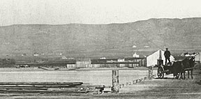 Panoramic view of the Berkeley hills from the Heywood & Jacobs wharf circa 1868.  The peak of the roof of the white house in the central foreground points toward the Napoleon Byrne house,  whose landscaped front yard became Live Oak Park in 1915.