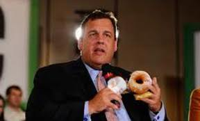 New Jersey Governor Chris Christie eating another donut.
