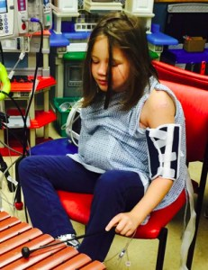 Emily Ruckle begins music therapy for her two mangled arms.