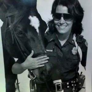 Beth Clifton as Miami Beach mounted patrol officer.