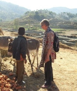 Lucia de Vries persuades brickyard child laborers to bring their equines for care––and tries to help the children,  too.  This donkey driver is blind.