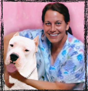Vet tech Beth Clifton with a pit bull
