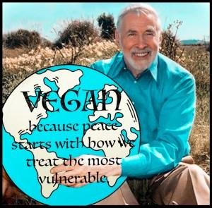 Elliot Katz holding a vegan globe