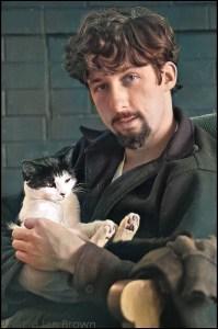 Tom Hayden with a cat