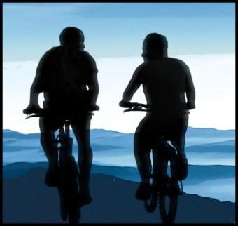 Two men riding bikes