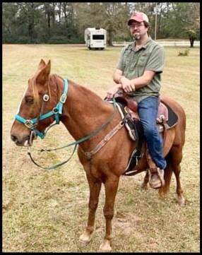 Nic Coker on horseback.