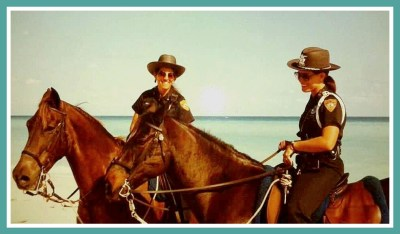 Beth Clifton, right, as Miami Beach mounted police officer.