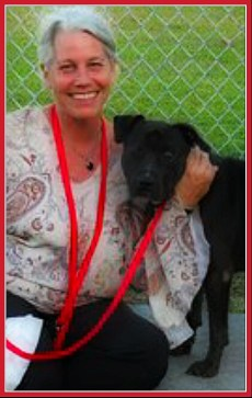 Beth Clifton with one of the pit bulls for whom she was a rescue driver.