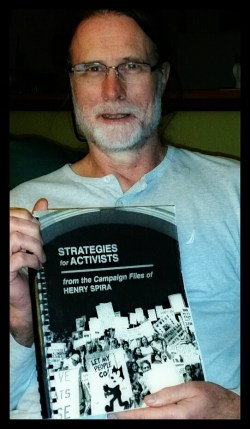 ANIMALS 24-7 editor Merritt Clifton with Strategies for Activists from the Campaign Files of Henry Spira. (Beth Clifton photo)