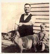"John P. Colby often posed his ""Staffordshire"" pit bulls with children."
