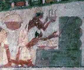 """An illustration on the walls of the sun temple of Nyuserre Ini (from the 5th Dynasty, circa 2422 BC) shows beekeepers blowing smoke into hives in order to remove the honeycomb."" (From https://ferrebeekeeper.wordpress.com/tag/beekeeping/)"