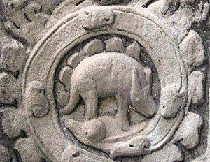 There is considerable controversy as to just what this ancient Cambodian carving shows––a pangolin?  A rhino?  Or perhaps a reconstruction of a stegosaurus from fossil evidence?  (http://paleo.cc/paluxy/stegosaur-claim.htm)