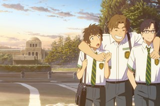 Three teen boys in school uniforms walk down a street