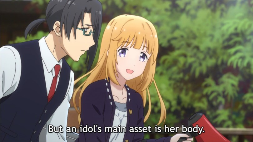 """Sachie, with long blonde hair and blue eyes, smiles as she speaks to her worried assistant, a man in a white shirt, waistcoat, red tie and glasses, dark hair in a ponytail. Subtitle: """"But an idol's main asset is her body."""""""