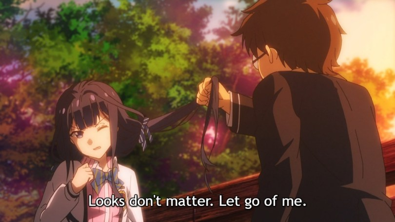 """A male classmate with glasses pulls on Aki's long hair as she winces. Subtitle: """"Looks don't matter. Let go of me."""""""
