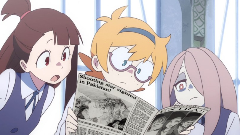 The Little Witch Academia girls look at a newspaper