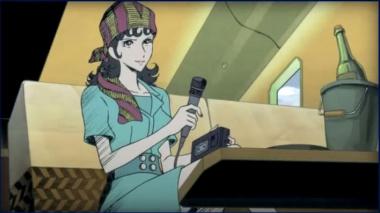A dark-haired woman sitting on couch, holding out a 60s microphone and holding a tape recorder.