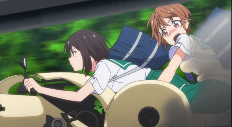 two girls on a makeshift sidecar; one is flustered, the other intent
