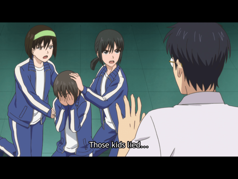 Two girls in track suits comforting a third crying girl, glaring at a teacher. caption: those kids lied