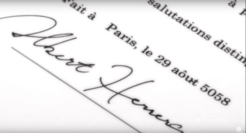 Cursive script reading Albert Herrera at the bottom of a printed letter
