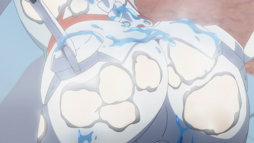 A close-up of a girl's butt as a blue liquid eats through her clothes, resulting in large holes exposing her skin.