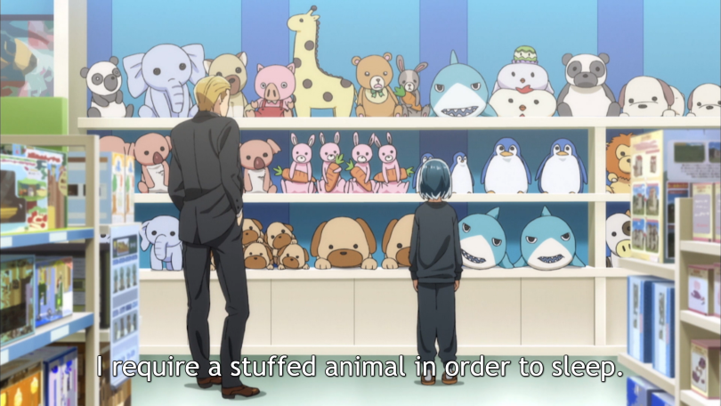 """A man with blonde hair and a girl in loose-fitting clothes standing in front of a wall of cute, plush stuffed animals. Subtitles read: """"I require a stuffed animal to sleep at night."""""""