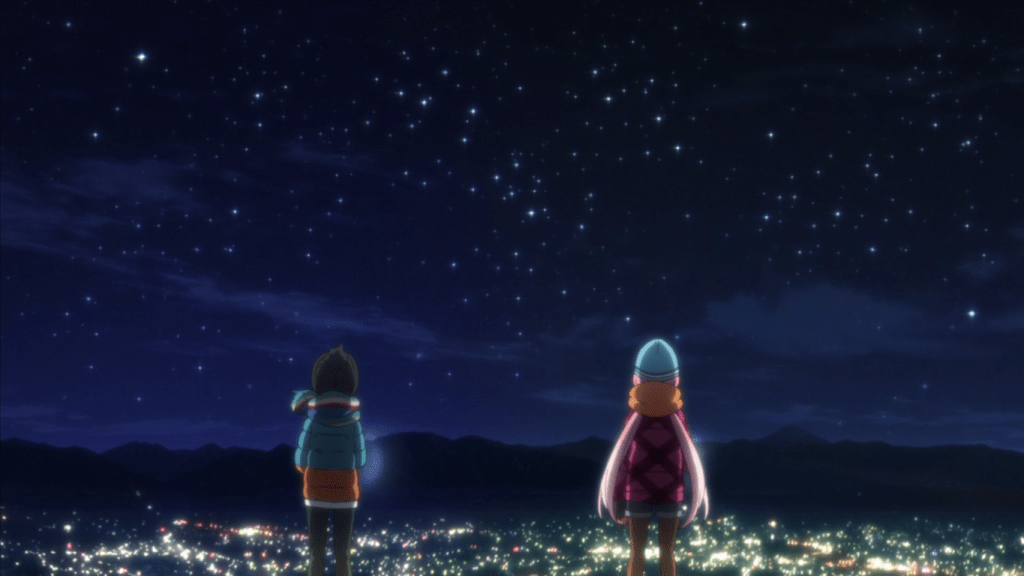 Two teen girls in winter clothes stare up at a star-strewn night sky. A cityscape spreads out below them.