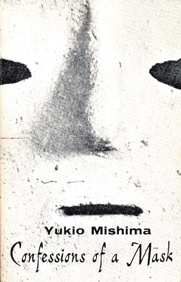 the cover of Confessions of a Mask with a close-up of a crude white mask