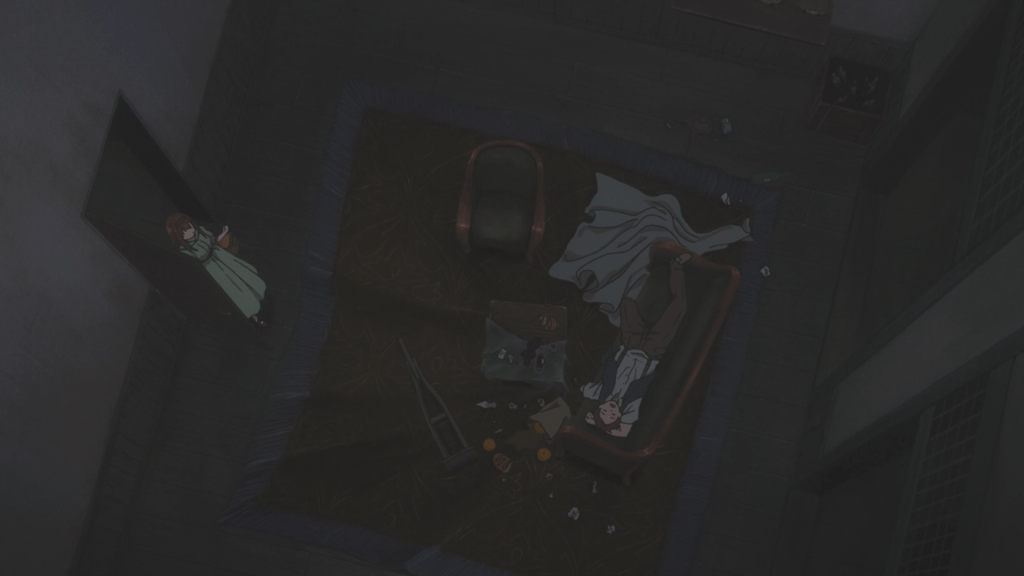 The camera looks down from the ceiling at Spencer, who lies asleep on a sofa with rubbish food and spilt drink surrounding him.
