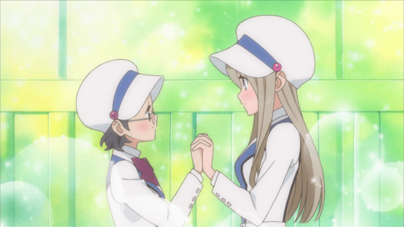 Two girls in matching school uniforms hold hands and smile at each other. Sparkles burst out around them.